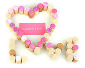 Wine corks laid out in form of heart isolated on white — Stock Photo