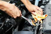 Hand with wrench. Auto mechanic in car repair — Stok fotoğraf