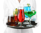 Waitresses holding tray with glasses of cocktails, isolated on white — Stock Photo
