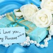 Stock Photo: Romantic parcel on blue cloth background