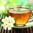 Cup of tea with jasmine, on bamboo mat, close-up — Stock Photo #30611723