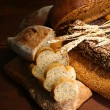 Much bread on wooden board — Stock Photo #30617625