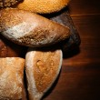 Much bread on wooden board — Stock Photo #30617635