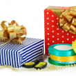 Tapes for wrapping gifts with holiday gifts isolated on white — Stock Photo