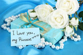 Romantic parcel on blue cloth background — Stock fotografie
