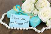 Romantic parcel on wooden background — Stock Photo