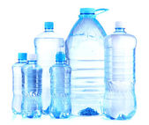 Bottles of water, isolated on white — Stock Photo