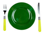 Knife, color plate and fork, isolated on white — Stock Photo