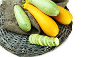Sliced and whole raw zucchini, isolated on white — Stock Photo