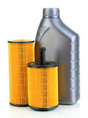 Car oil filters and motor oil can isolated on white — Stock Photo
