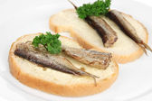 Tasty sandwiches with sardines, close-up — Stock Photo