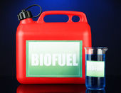 Bio fuels in canister and vial on blue background — Stock Photo