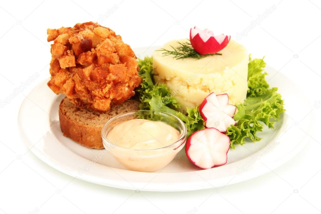 Chicken Kiev on croutons with mashed potatoes, isolated on white ...