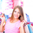 Beautiful young womin shop with shopping bags — Stock Photo #30673745