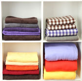 Brilhantes toalhas e mantas nas prateleiras, isoladas no branco — Foto Stock