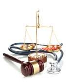 Medicine law concept. Gavel, scales and stethoscope isolated on white — Foto Stock