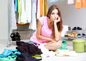 Beautiful girl thinking what to dress in walk-in closet — Foto de Stock