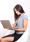Young beautiful business woman with laptop in office — Stock Photo