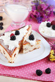 Cheese casserole with raisins on plate on napkin on wooden table close-up — Stock Photo