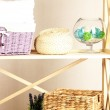 Beautiful white shelves with different home related objects, on color wall background — Stock Photo #30687429