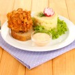 Chicken Kiev on croutons with mashed potatoes, on wooden background — Stock Photo