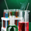 图库照片: Laboratory glassware on dark color background