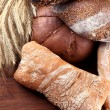Much bread on wooden board — Stock Photo #30688939