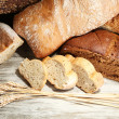 Much bread on wooden board — Stock Photo #30689137