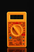 Multimeter on black background — Stock Photo