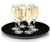 Many glasses of champagne on the tray, isolated on white — Stock Photo