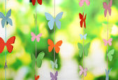 Handmade paper garland on bright background — Stock Photo