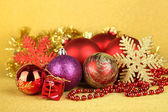 Christmas decorations on yellow background — Stockfoto