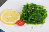 Sea kale on plate close-up — Stock Photo