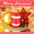 Red candle with christmas decoration on bright background — Stock Photo
