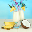 Pina colada drink in cocktail glasses, on bright background — Foto de Stock
