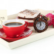 Cup of tea with cakes on wooden tray isolated on white — 图库照片