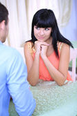 Beautiful young romantic couple in cafe — Stock Photo