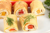 Egg rolls with cheese cream and paprika,on plate, close up — Stock Photo