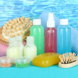Стоковое фото: Hotel cosmetics kit on bright color background