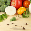 Stock Photo: Fresh vegetables in basket on wooden table close-up