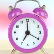 Alarm clock on table on light background — Stock Photo