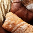 Much bread on wooden board — Stock Photo #30884883
