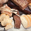 Much bread on wooden board — Stock Photo #30884887