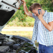 Stock Photo: Mcalling repair service after car breakdown