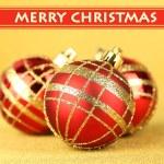 Christmas balls on yellow background — Stock Photo #30885011