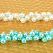 Stockfoto: Color beads on bright background, close-up