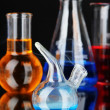 Laboratory glassware on black background — ストック写真