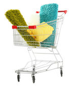 Shopping cart with colorful carpets and plaids, isolated on white — Stock Photo