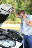 Man calling repair service after car breakdown — Foto de Stock