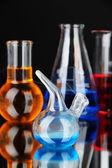 Laboratory glassware on black background — Stock Photo